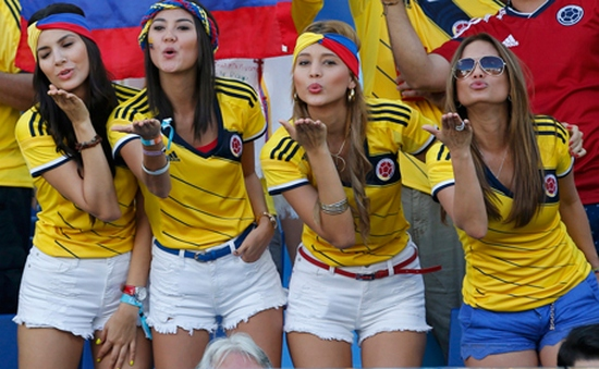 Colombia fans blow kisses before the 2014 World Cup Group C soccer match between Japan and Colombia at the Pantanal arena